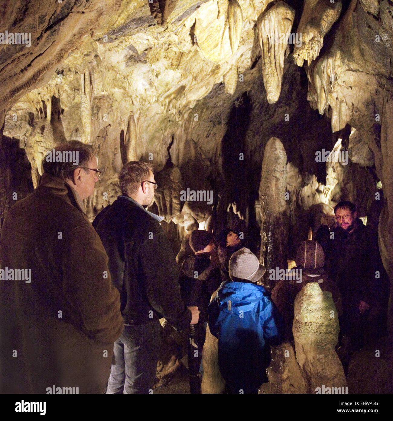 Visitors in the Bilsteinhöhle in Warstein. - Stock Image