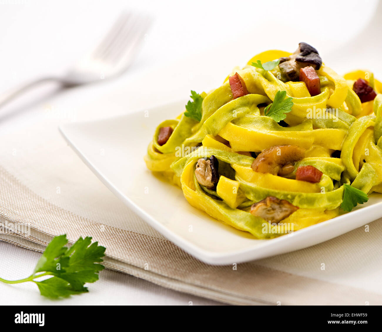 Paglia e fieno, or Straw and hay, tagliatelle Italian pasta with a mixture of yellow and green spinach-flavored - Stock Image