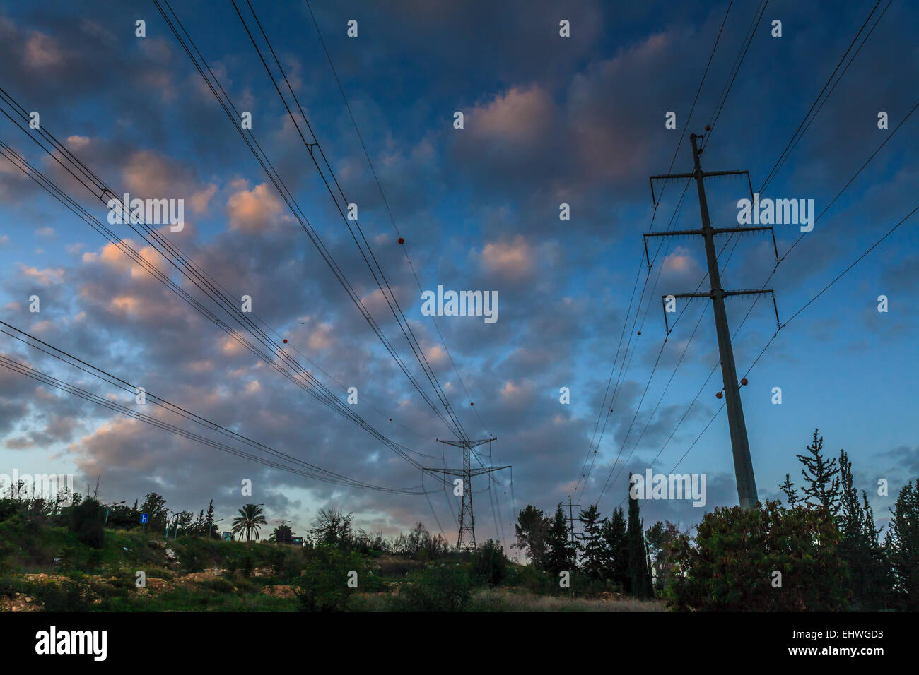 Power Pylons at Dawn Photographed near Rosh Haayin, Israel - Stock Image