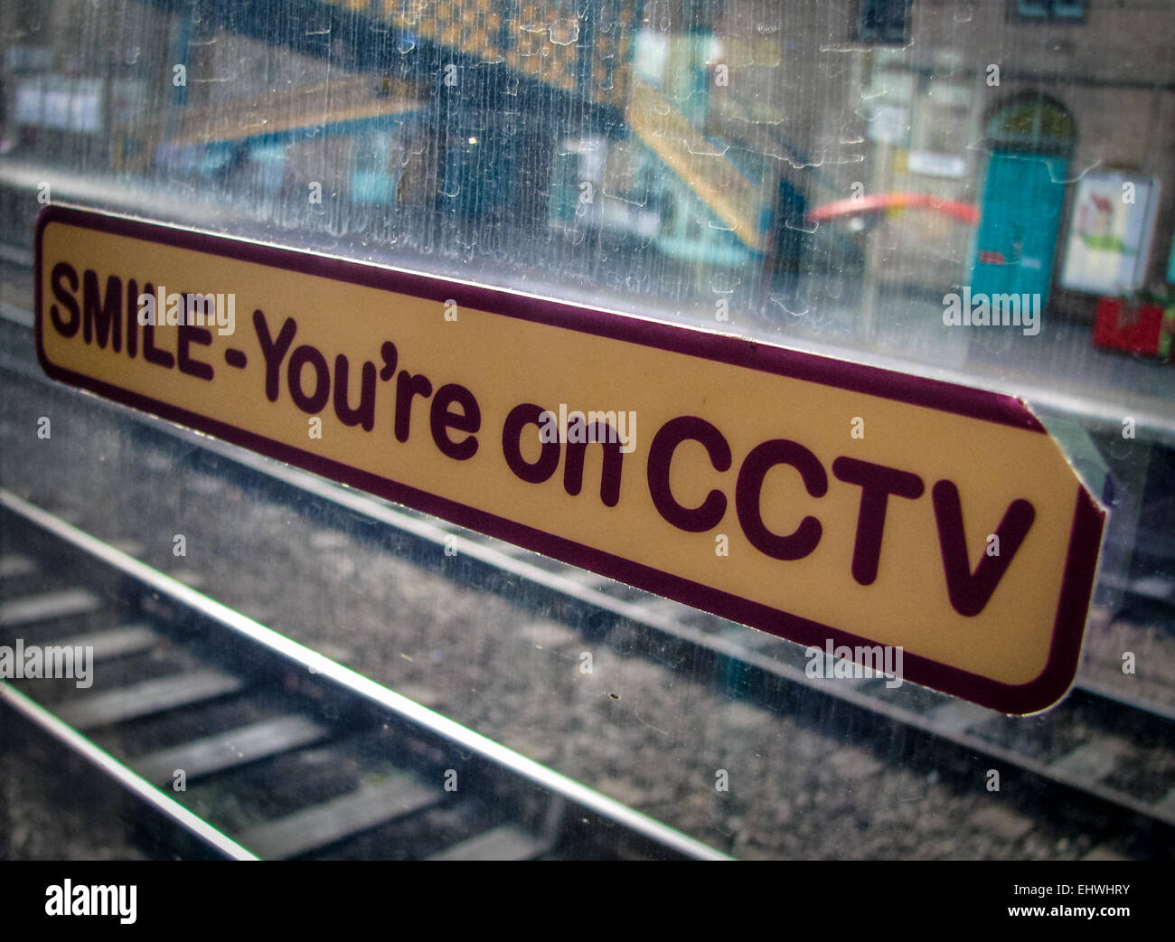 CCTV Sticker Sign On A Train Window In A Station - Stock Image
