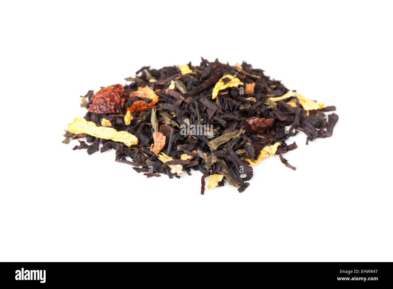 Pile of mixed black and green tea with dry rosehip berries, calendula, sunflower petals  isolated on white background Stock Photo