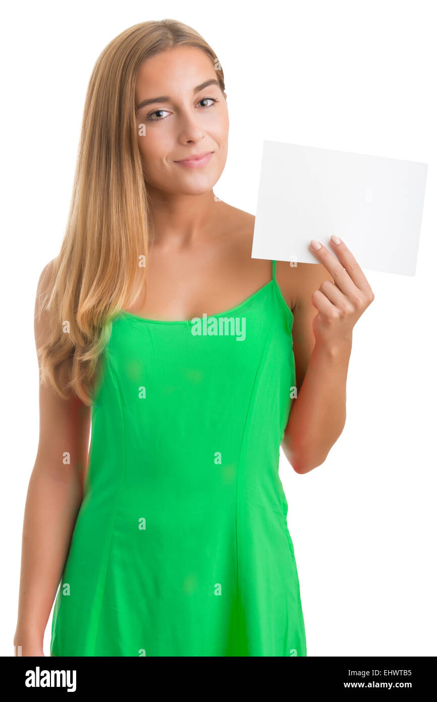 Young happy woman holding a blank business card on a white background - Stock Image