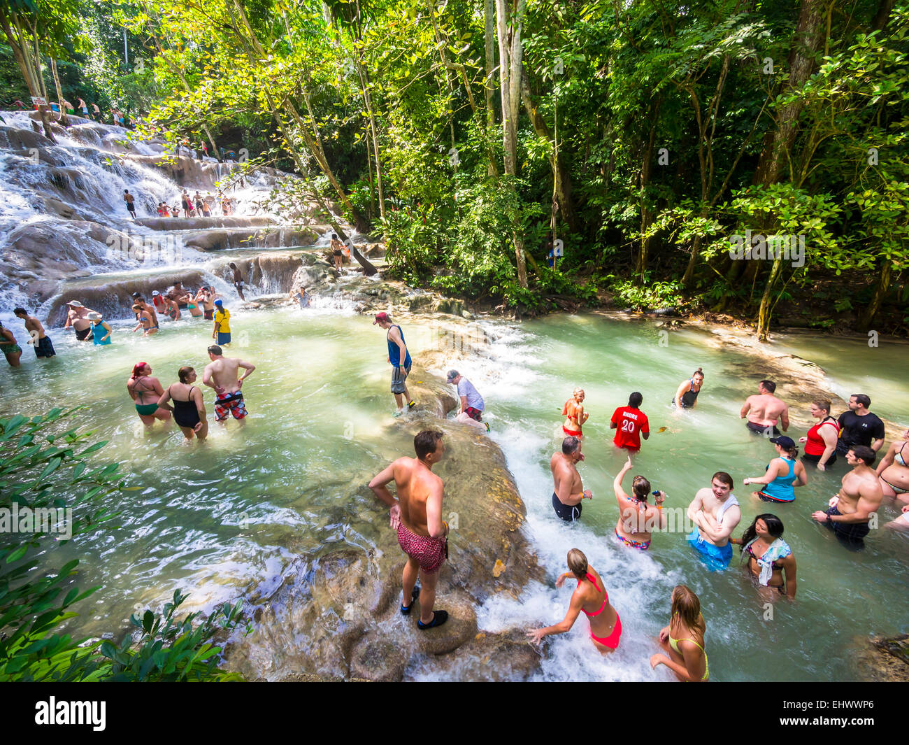 Jamaica, Ocho Rios, Tourists bathing in Dunn's River - Stock Image