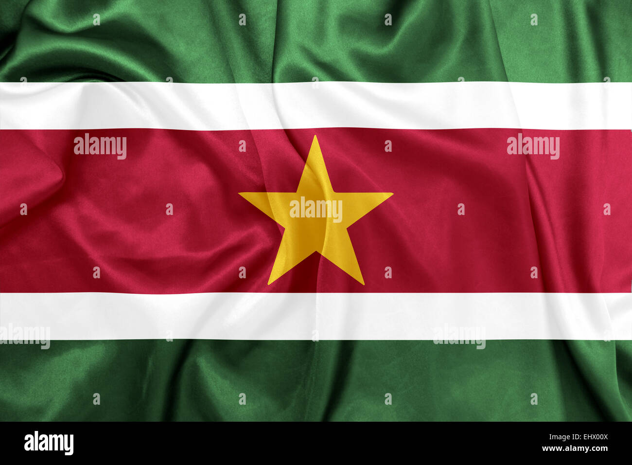 Suriname - Waving national flag on silk texture - Stock Image