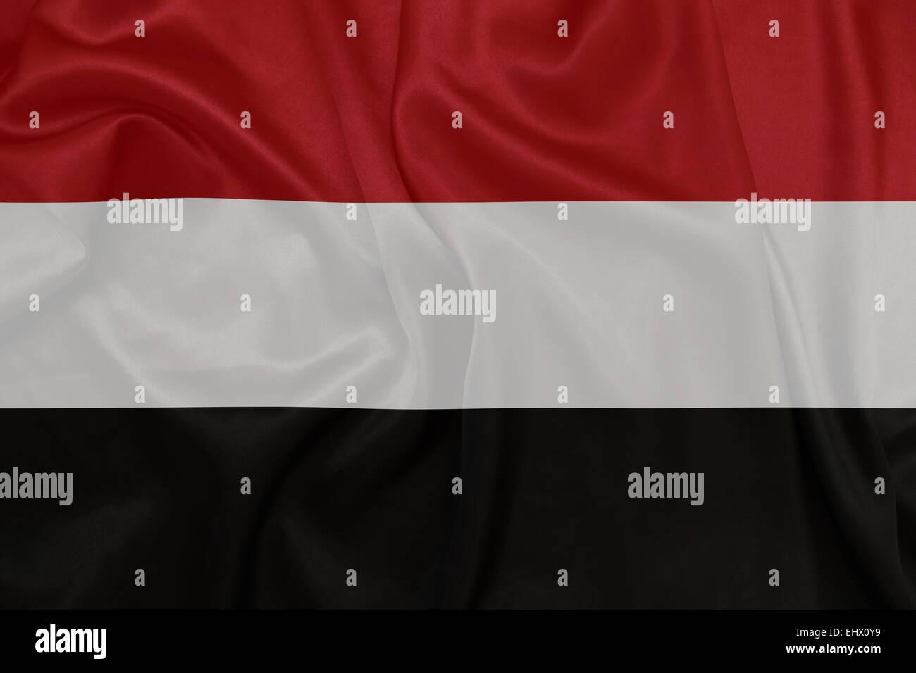 Yemen - Waving national flag on silk texture - Stock Image