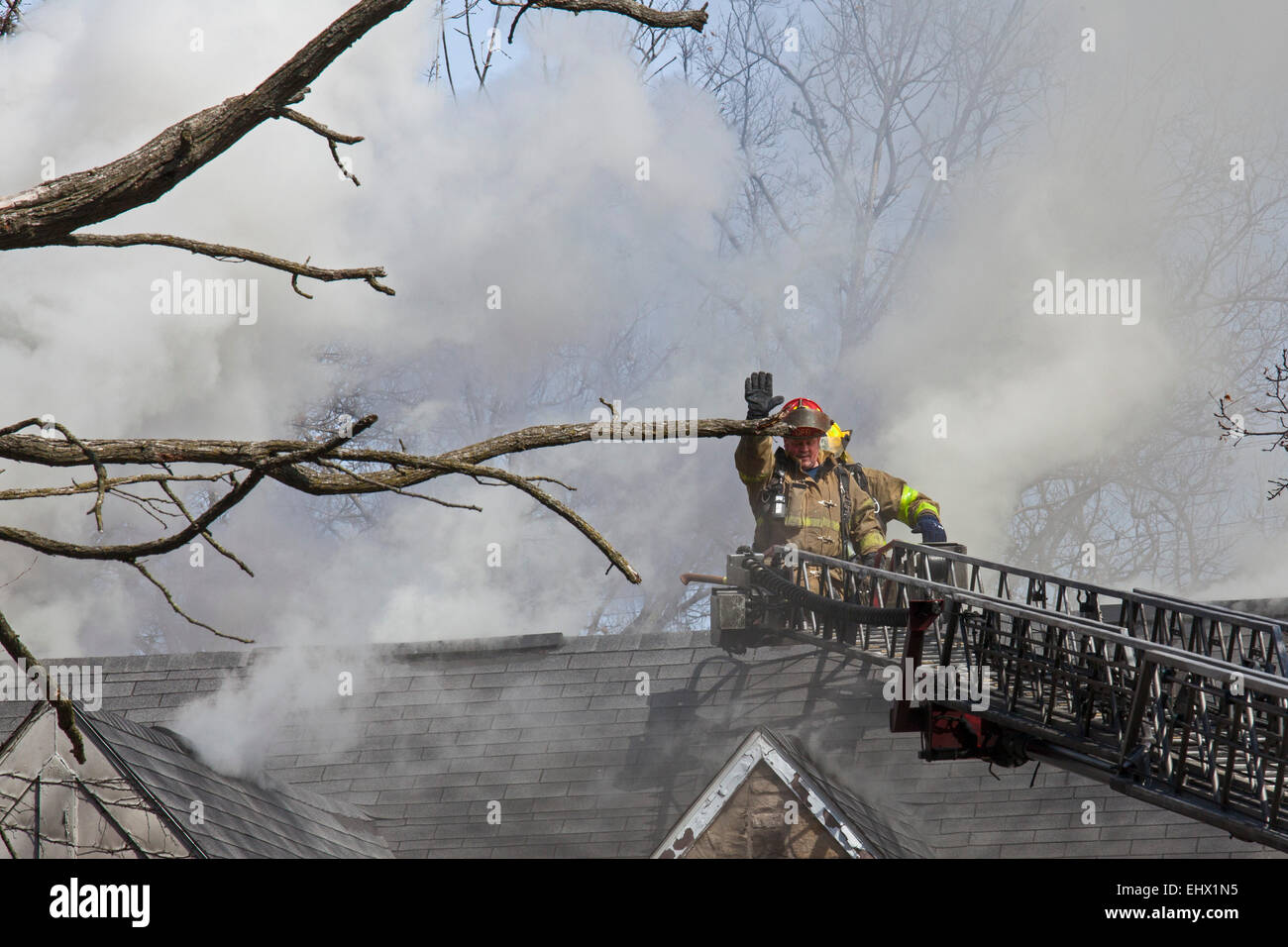Detroit, Michigan - Firefighters battle a fire which destroyed a vacant home in Detroit's Morningside neighborhood. - Stock Image