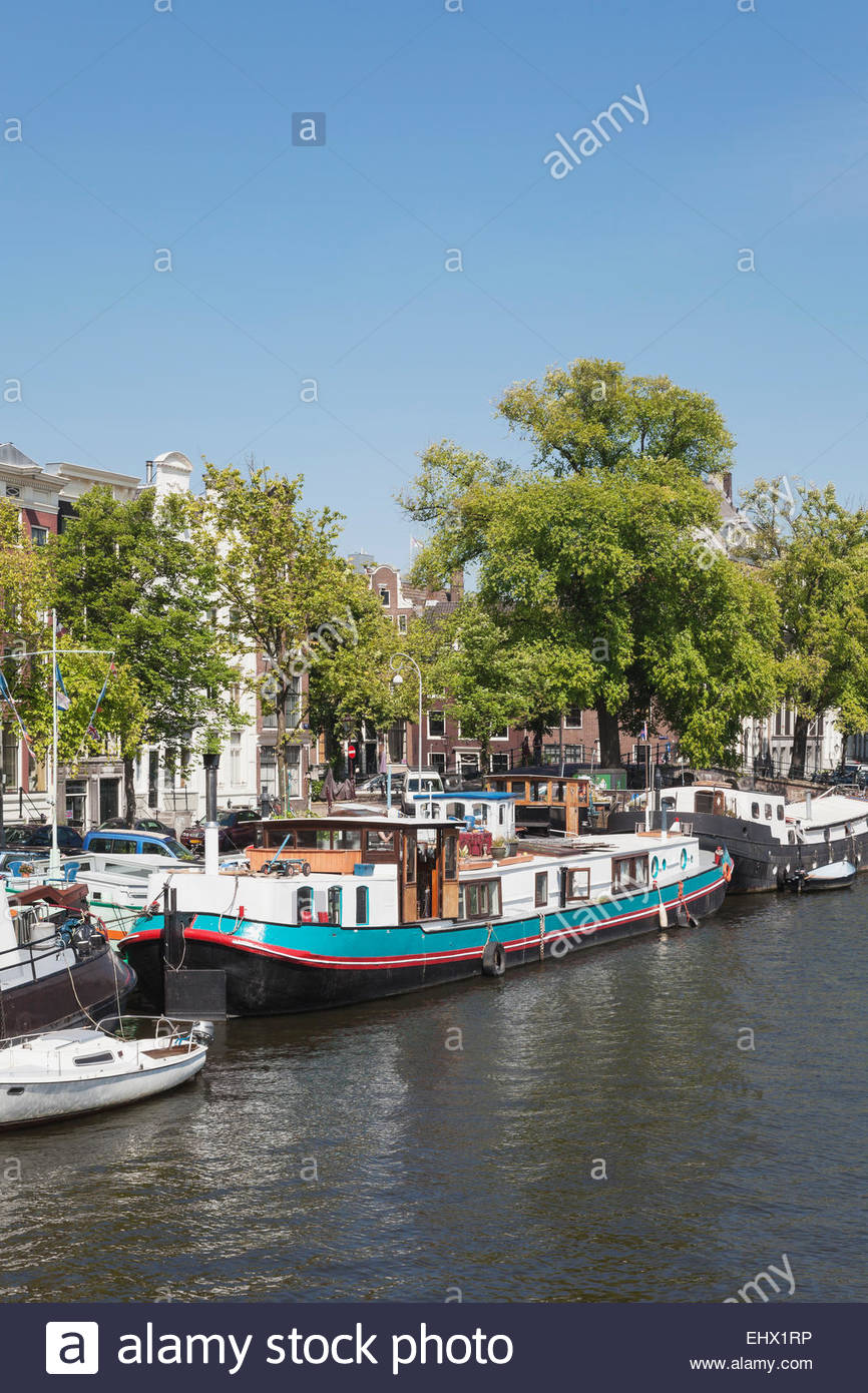 Netherlands, County of Holland, Amsterdam, House boat, Amstel river - Stock Image