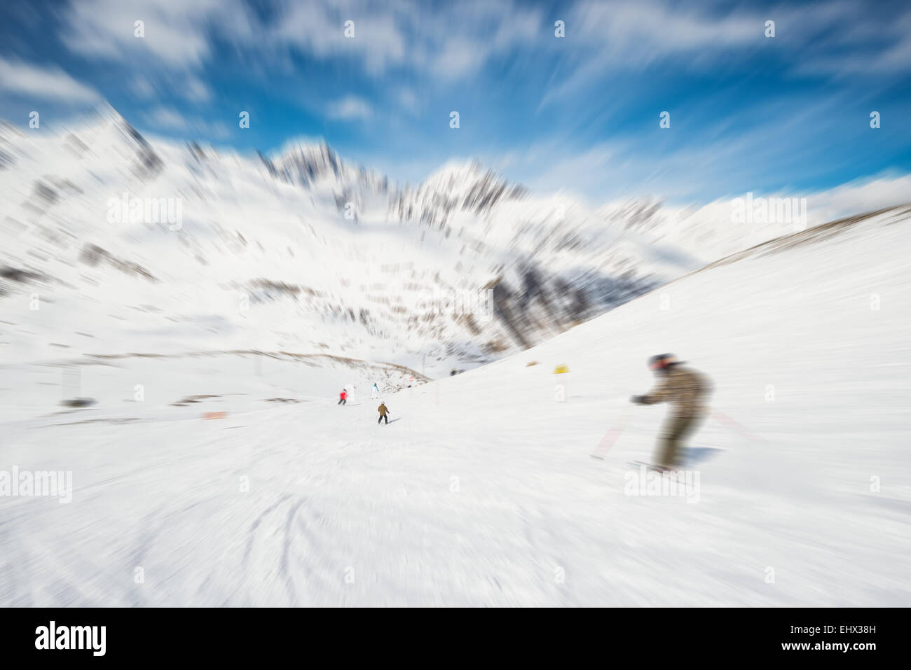 Speed skiing on snowy slope in the famous and scenic ski resort of La Thuile, Aosta Valley, Italy. Radial blurred - Stock Image