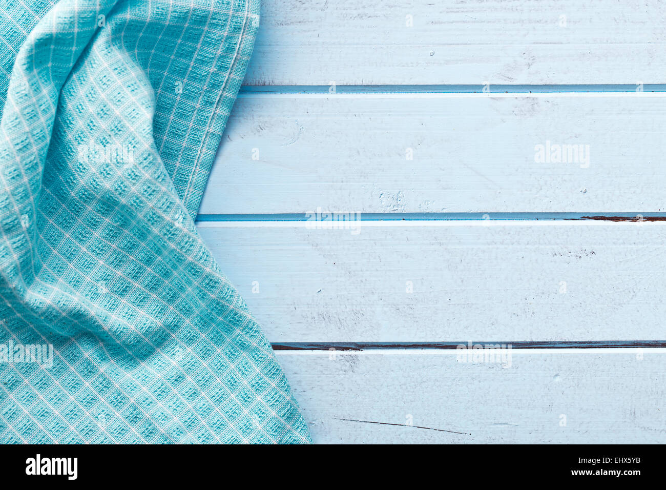 the background made from checkered napkin on blue table - Stock Image