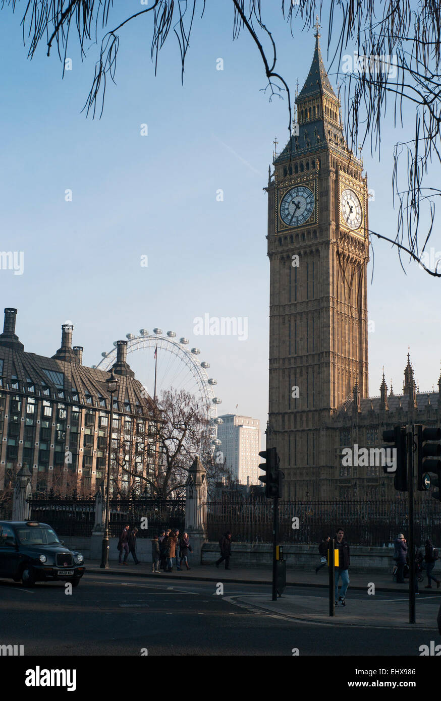Palace of Westminster, the clock tower, housing the Bell big Ben, London eye, portcullis house, black taxi Parliament - Stock Image