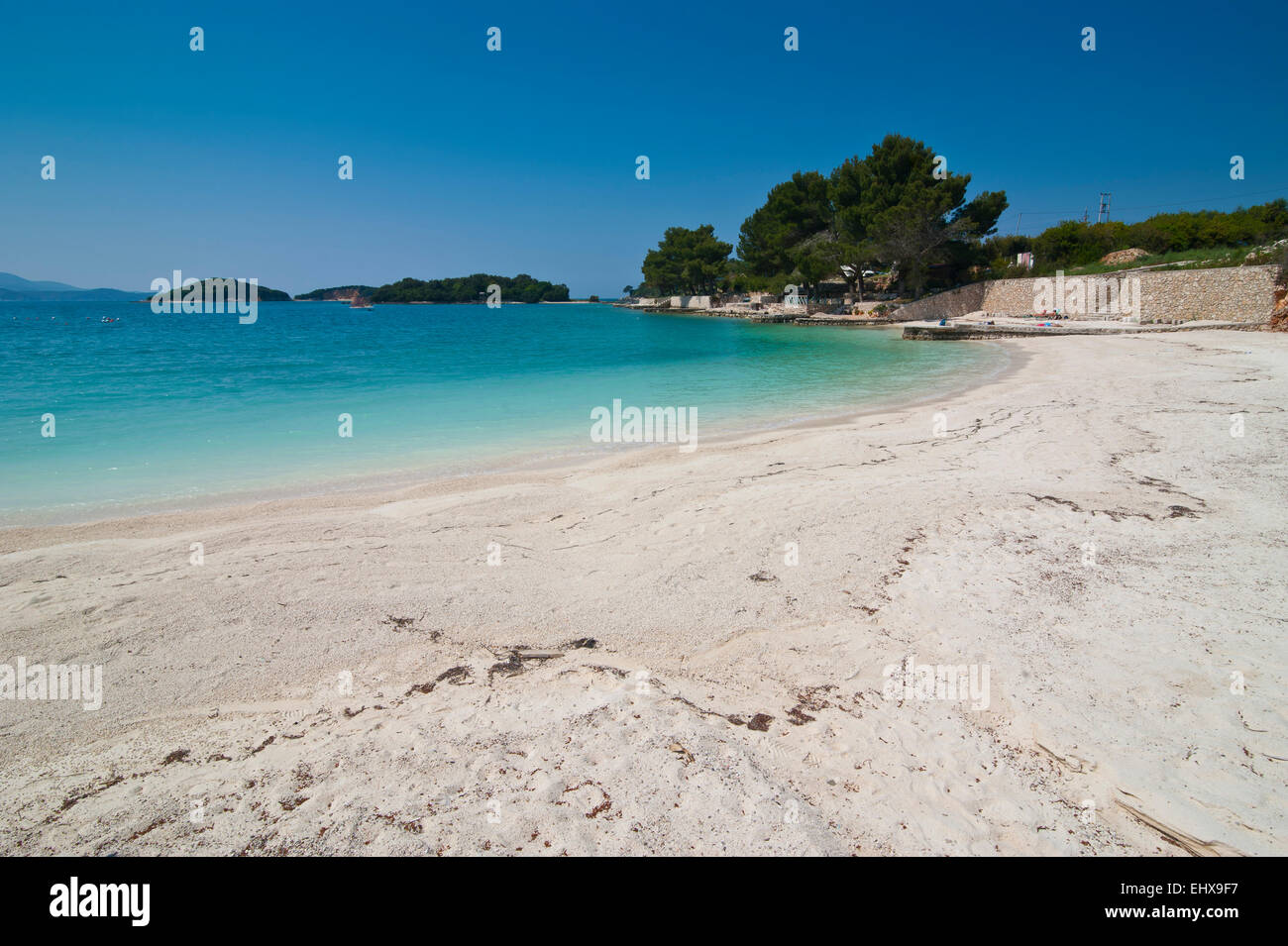 White sand beach and turquoise water at Ksamil, Albania - Stock Image