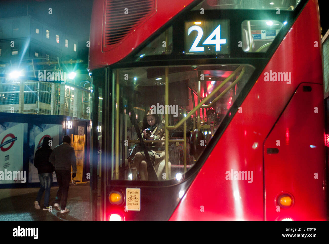 Routemaster Thomas Heatherwick's London's Hop-on, hop-off red double-decker bus at night - Stock Image