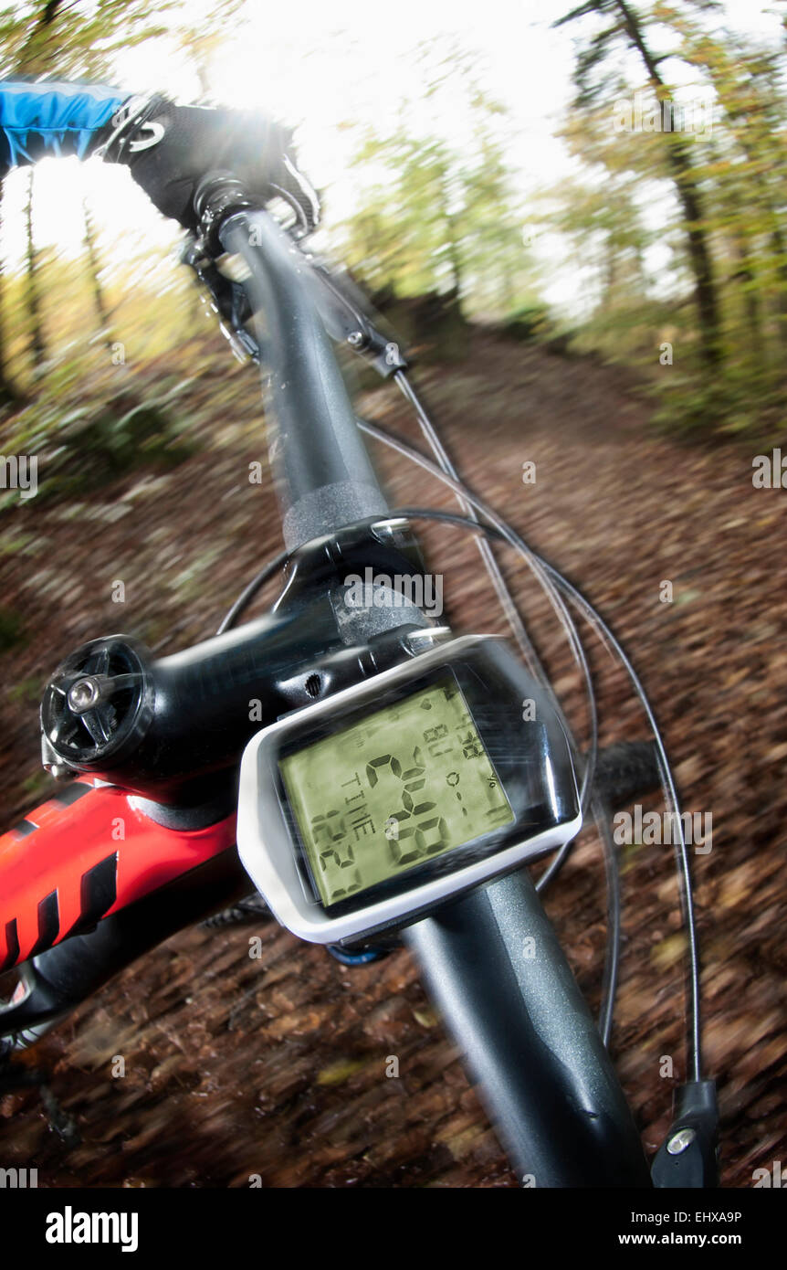 Mountain biking down hill descending fast on bicycle, Bavaria, Germany - Stock Image