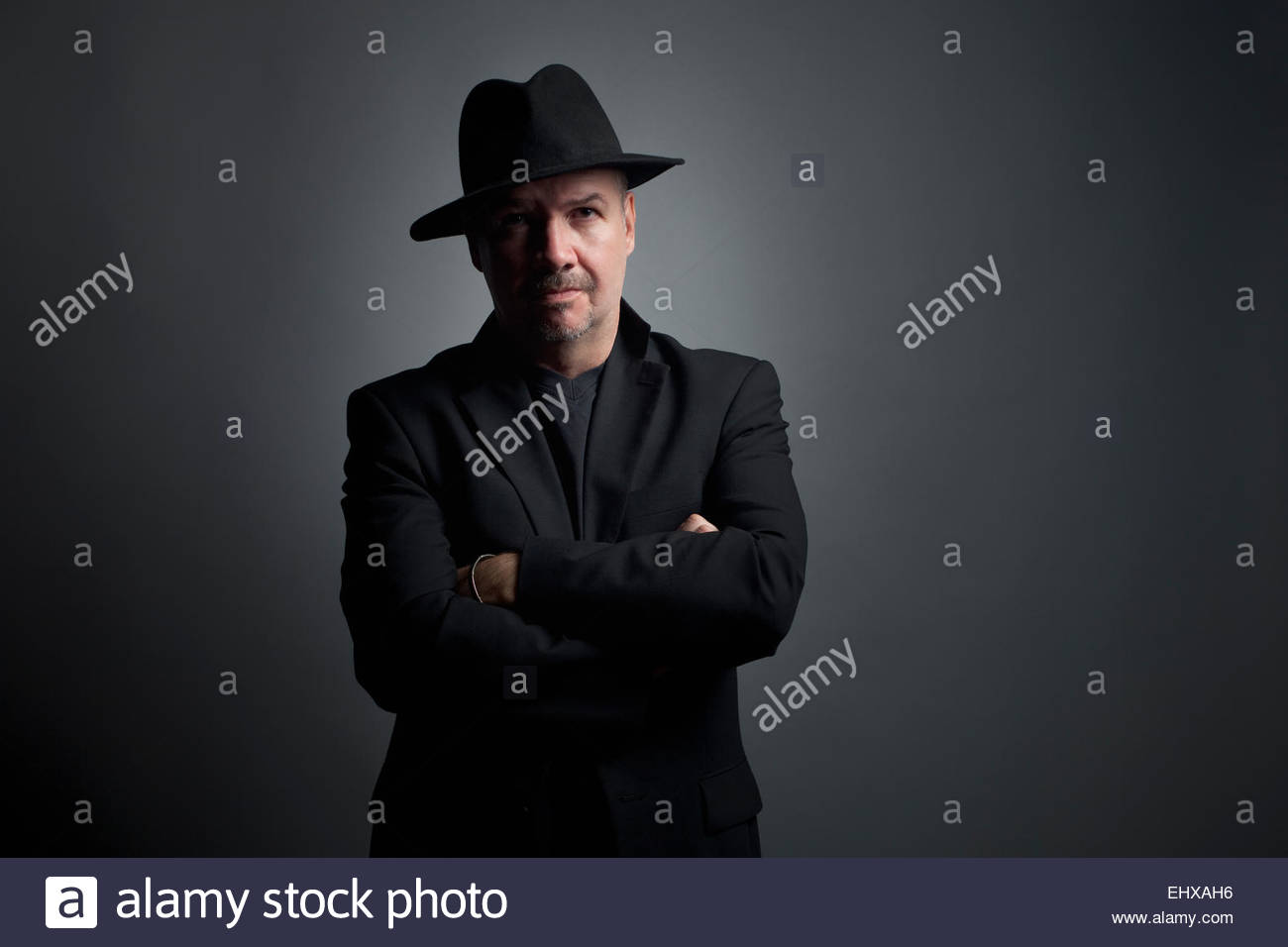 828b489fd5c7a Man portrait wearing fedora hat middle aged 40 - Stock Image