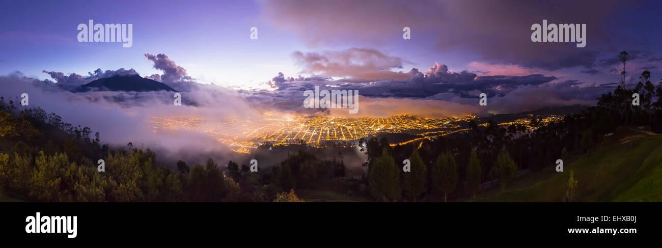 South America, Ecudador, Imbabura Province, Ibarra, blue hour and fog, Panorama - Stock Image