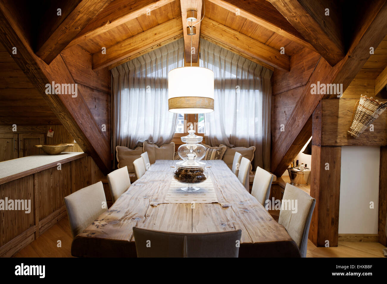 Alpine attic dining room table for eight seats - Stock Image