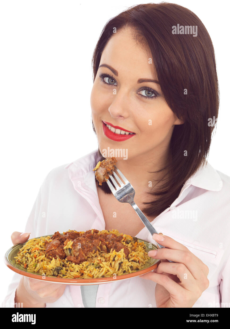 Attractive Young Woman Eating Lamb Rogan Josh Indian Curry - Stock Image