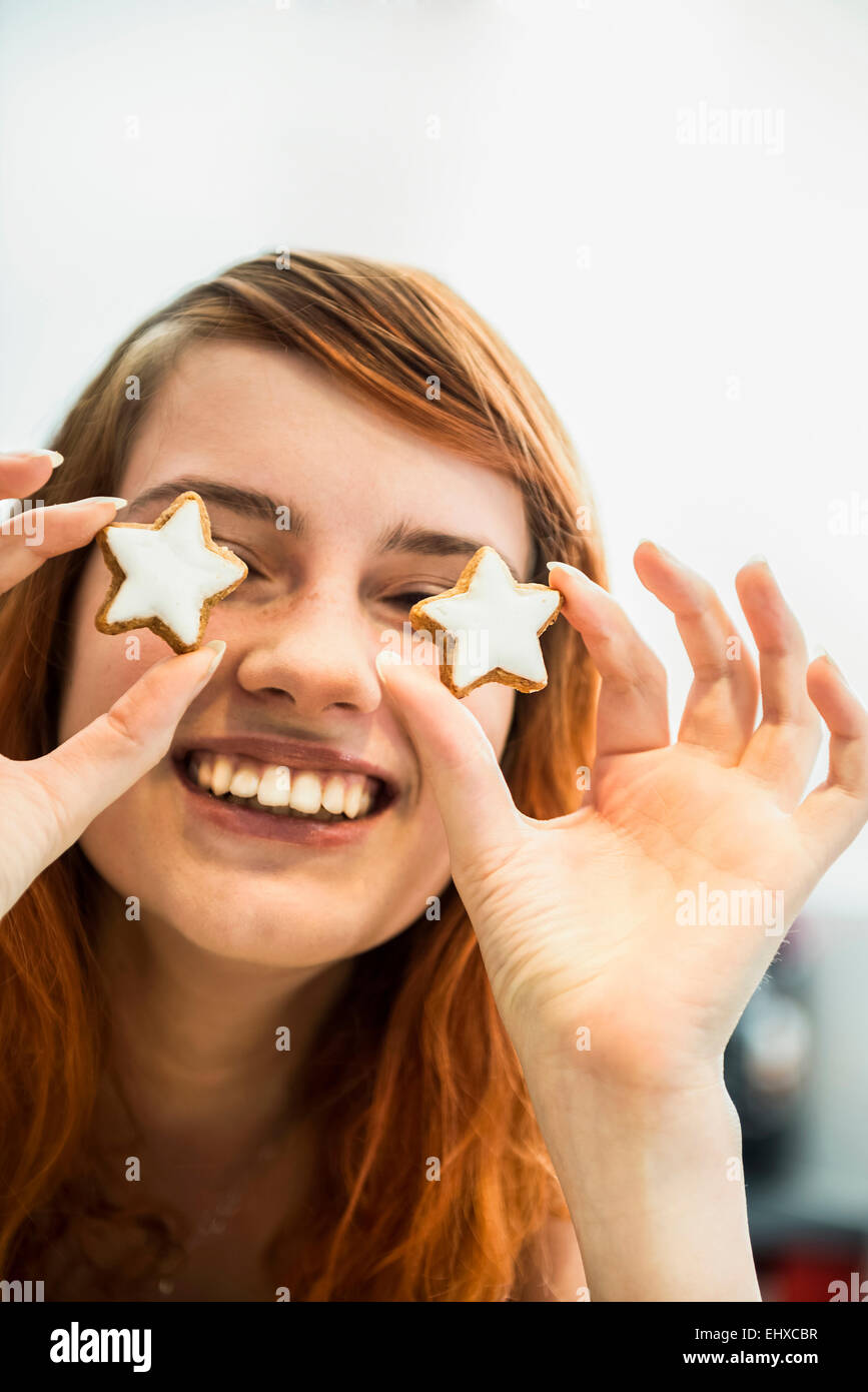 Close up of a red-haired young woman with cinnamon stars as eyes, Munich, Bavaria, Germany - Stock Image
