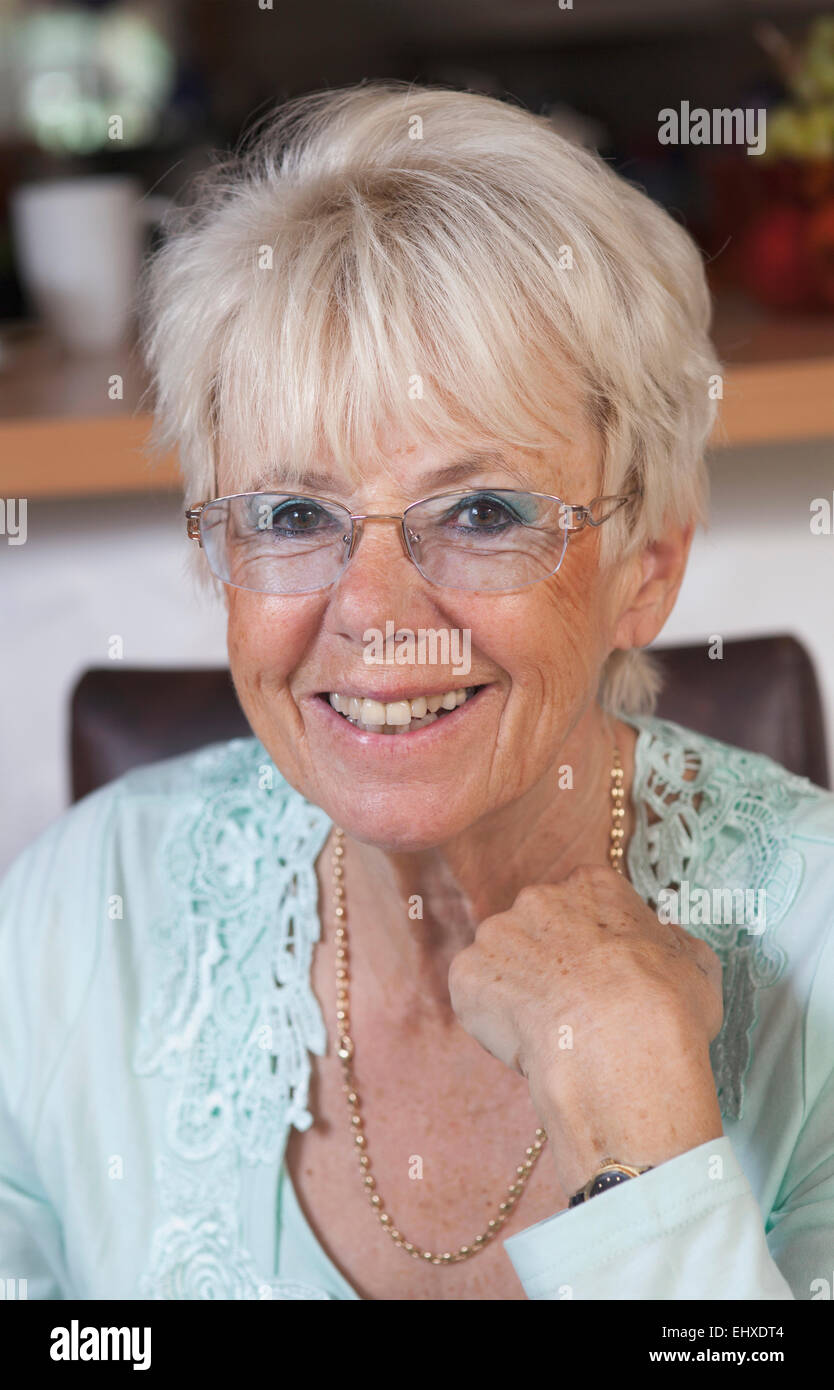 Portrait of a senior woman smiling, Bavaria, Germany - Stock Image