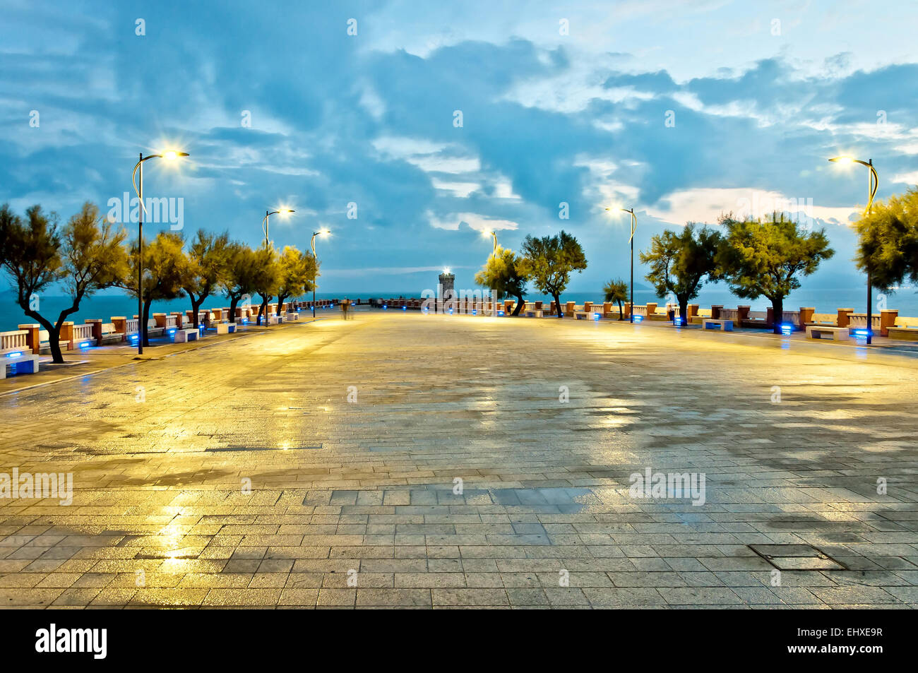 Mediterranean sea with cloudy sky seen from Piazza Bovio in Piombino town - Tuscany, Italy - Stock Image