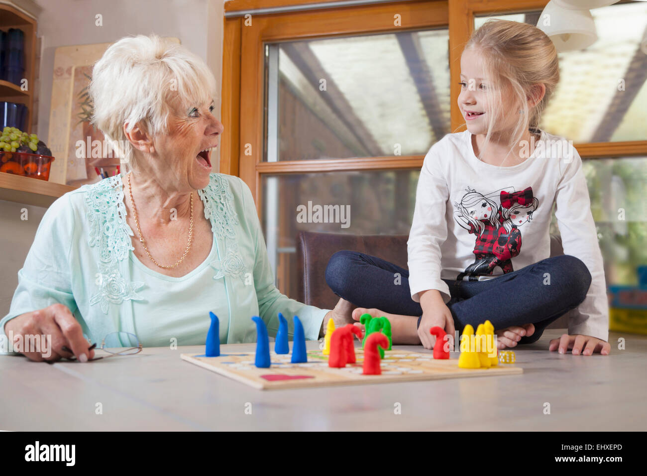 Girl playing board game with her grandmother, Bavaria, Germany - Stock Image