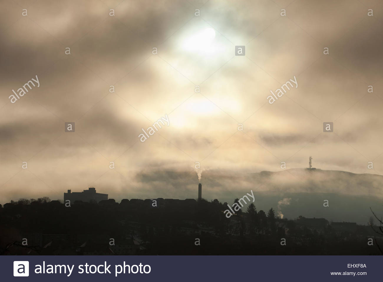 Silhouette smog pollution town chimney smoke - Stock Image