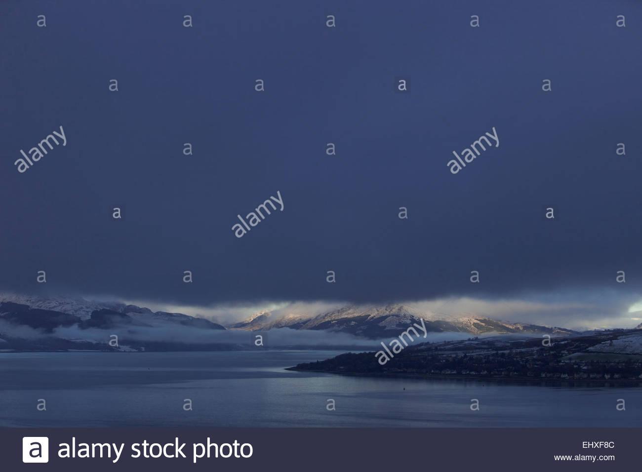 Mountain landscape stormy snow dark sky winter - Stock Image