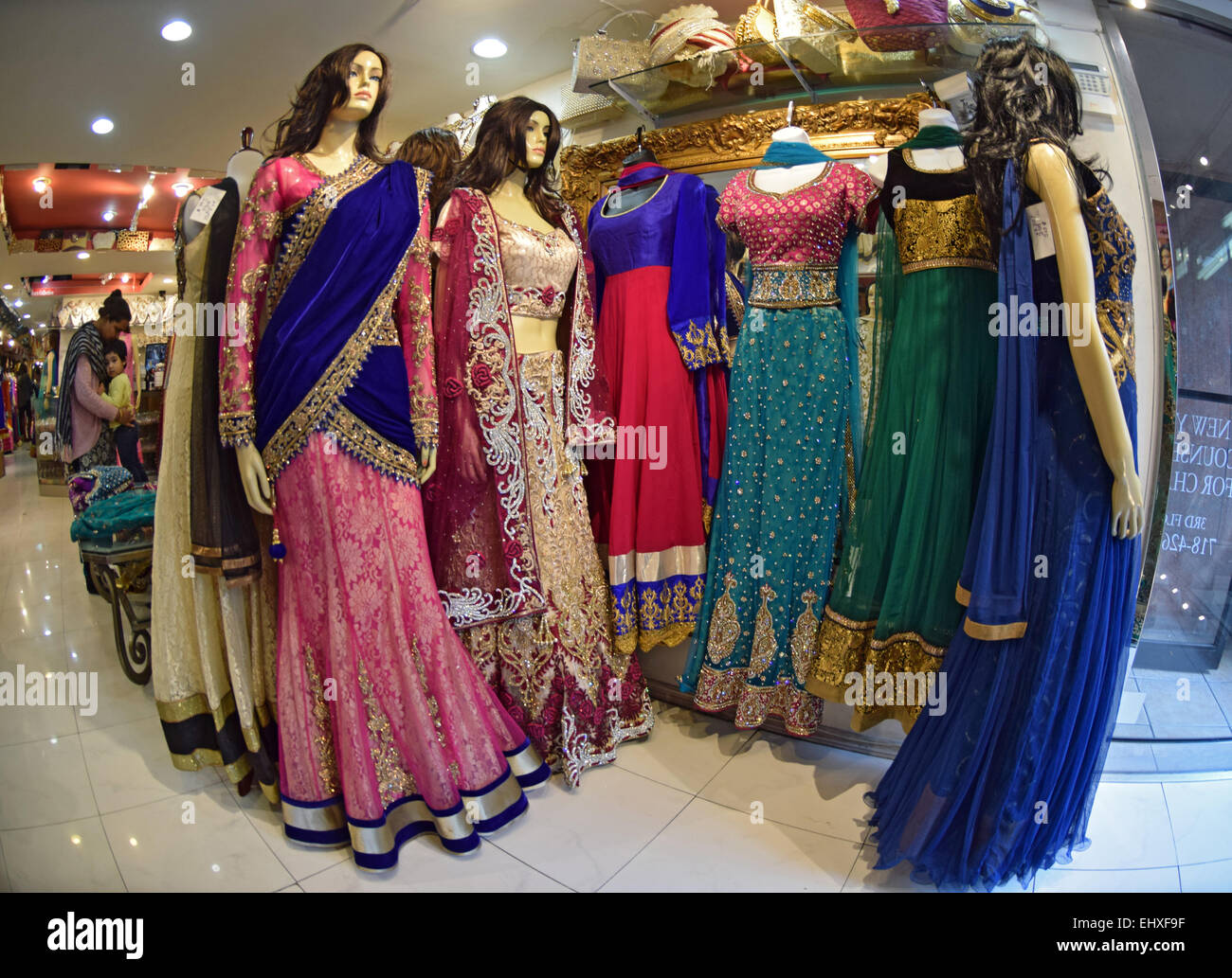 Mannequins in women's wedding saris in the Indian shop Pirani on 74th Street in Jackson Heights, Queens, New York Stock Photo