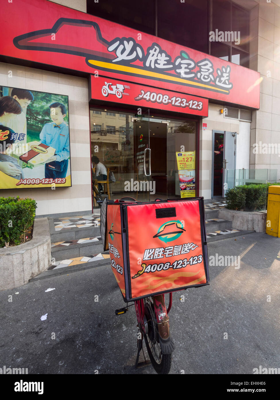 Delivery Motorcycle Outside A Pizza Hut Restaurant In Shanghai