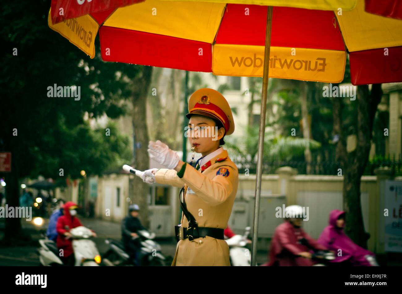 Police woman, Hanoi, Vietnam - Stock Image