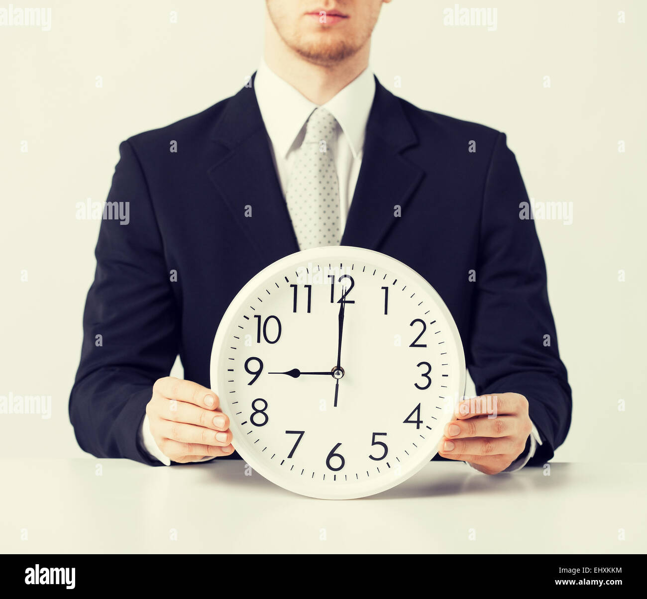 man with wall clock - Stock Image
