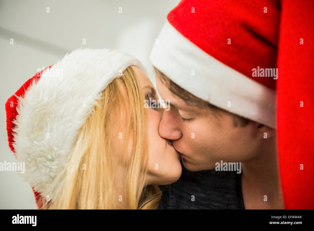 Young couple romancing on Christmas eve, Munich, Bavaria, Germany - Stock Image