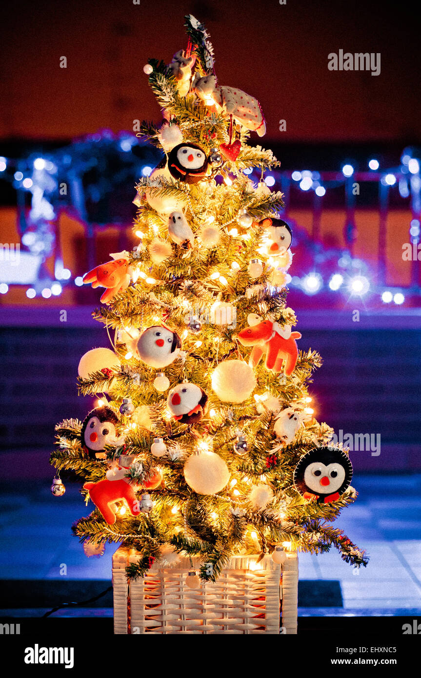 decorated Christmas tree with de-focused lights background - Stock Image