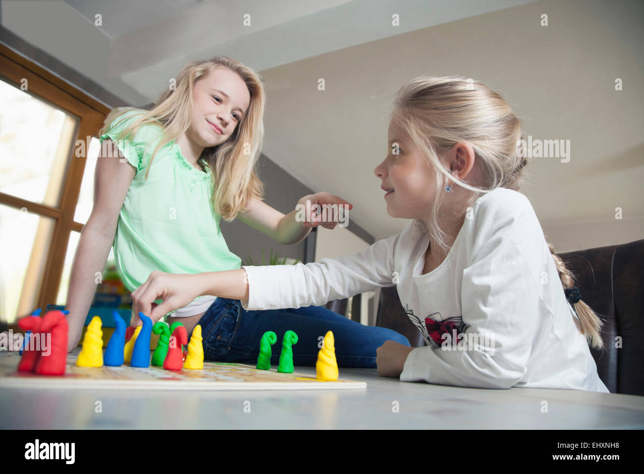 Two sisters playing board game, Bavaria, Germany - Stock Image