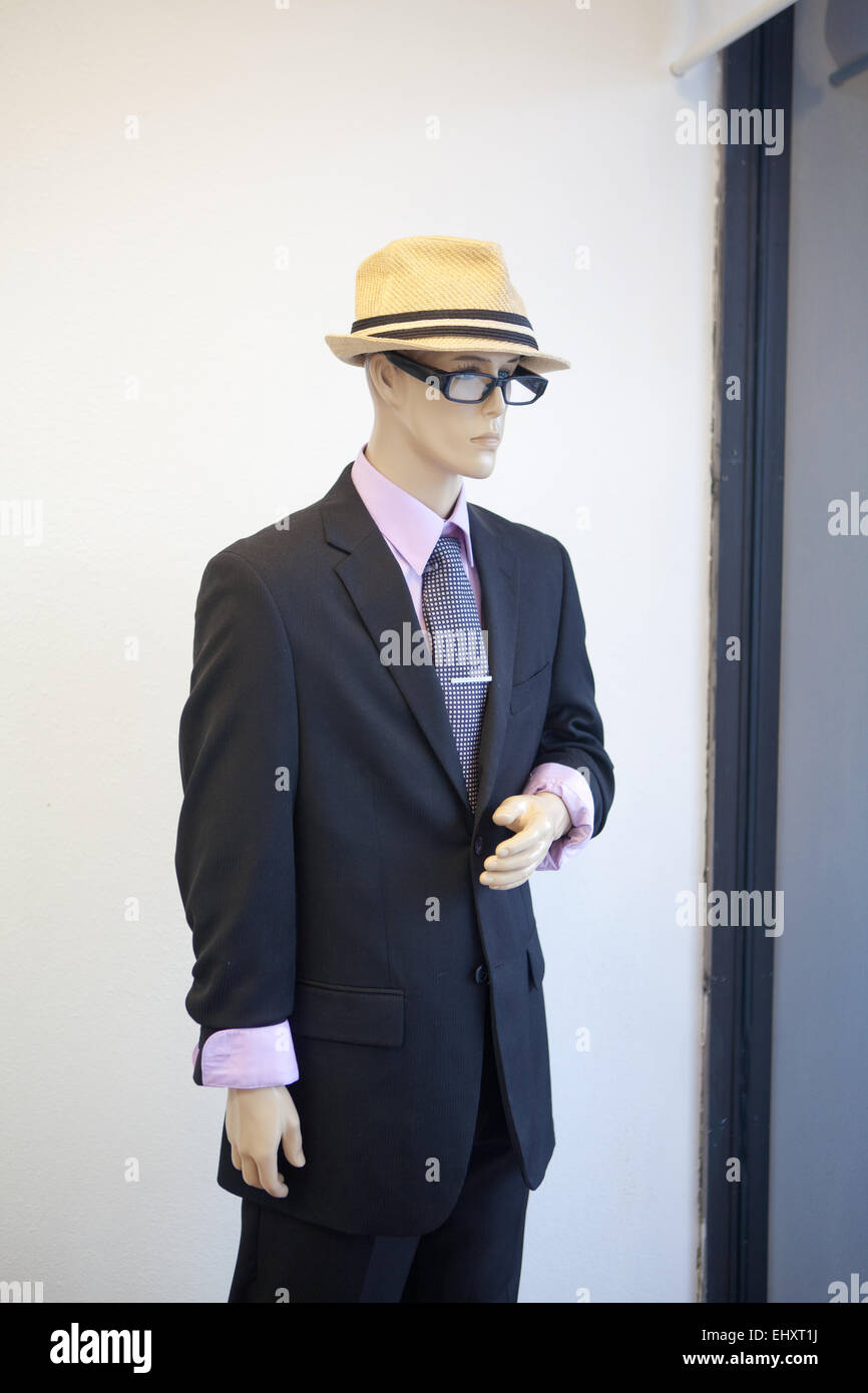 Male Mannequin, window, spy, security, glasses, fedora hat, black suite, tie - Stock Image