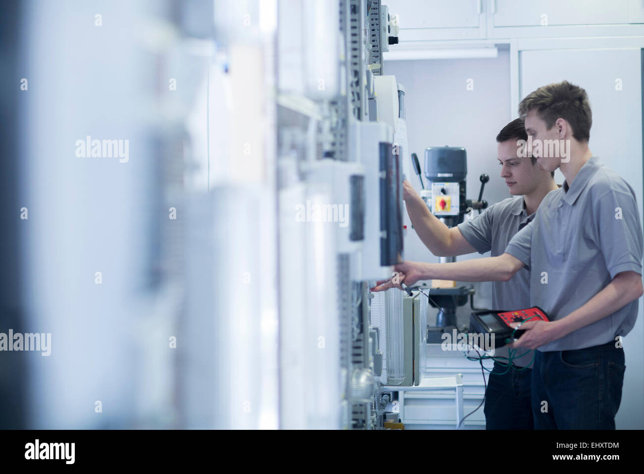 Students at electronics vocational school - Stock Image