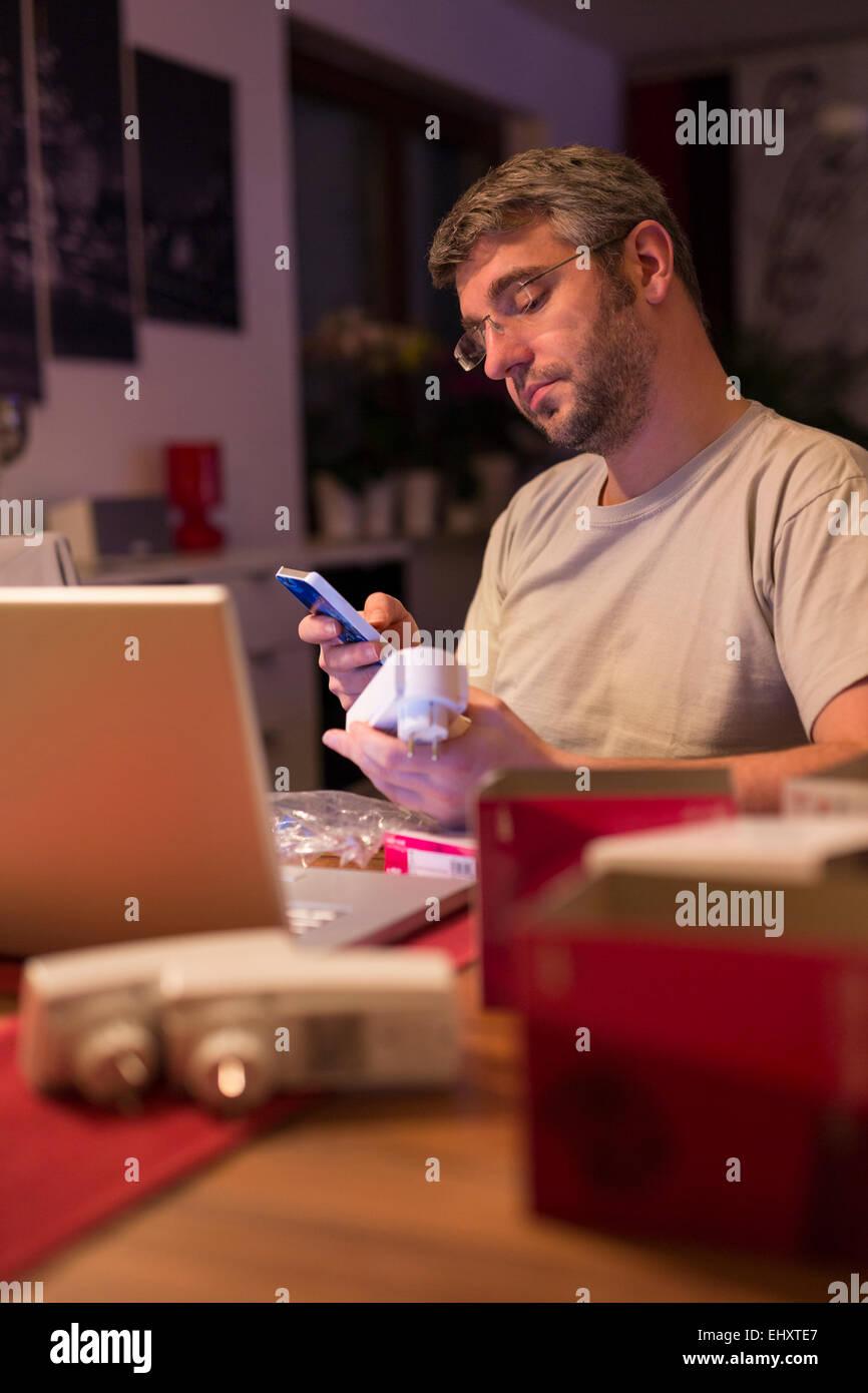 Man installing wireless sockets Stock Photo