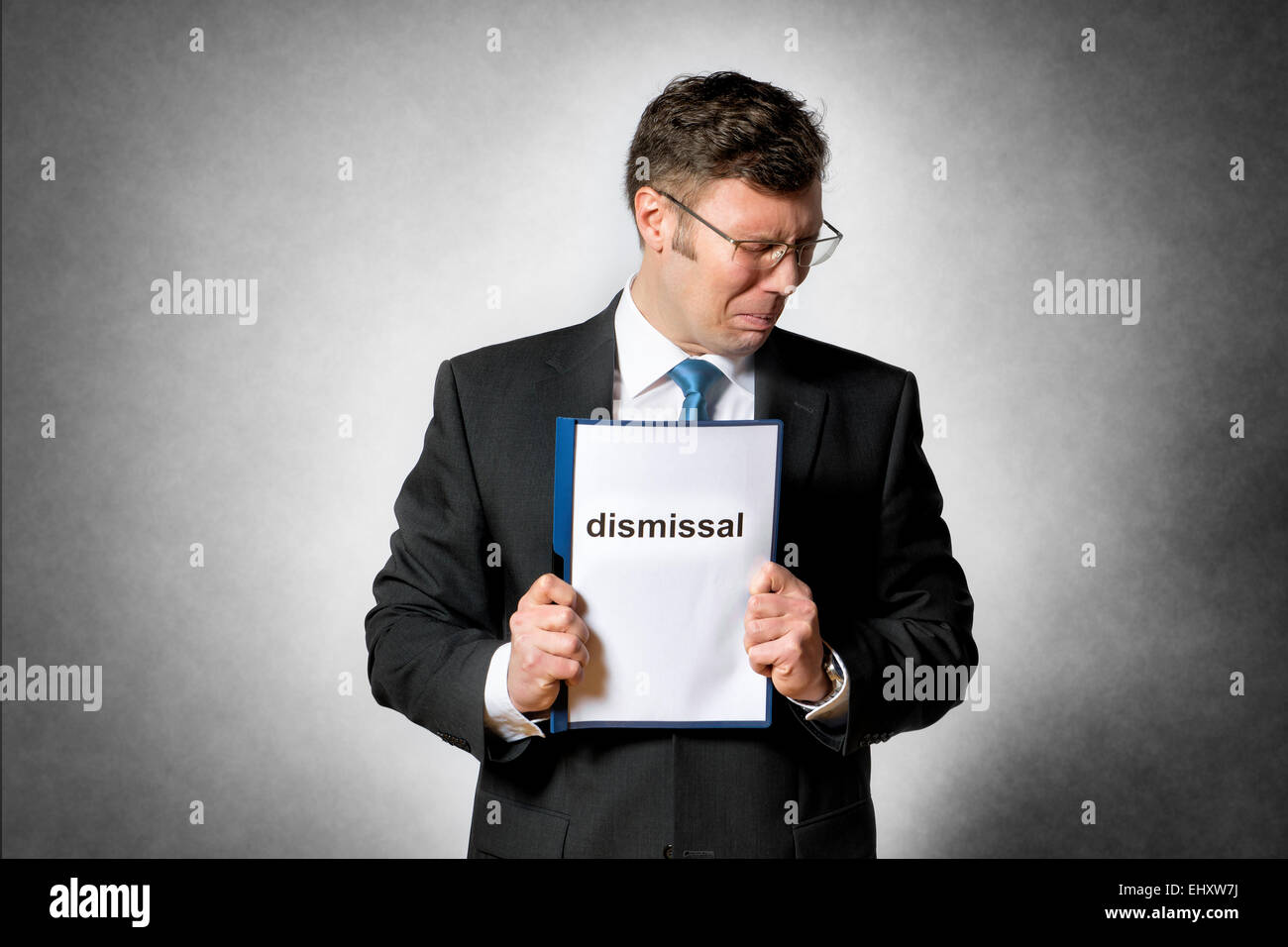 Image of frustrated business man who is fired - Stock Image