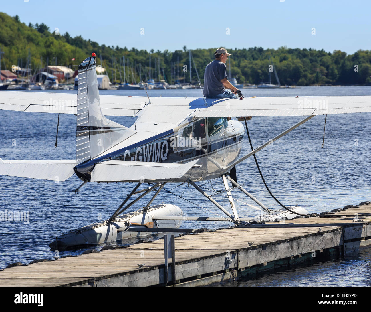 Man refueling a float plane, Parry Sound, Ontario, Canada - Stock Image