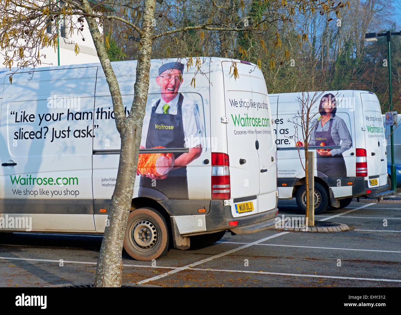 Waitrose delivery vans in car park, Emgland UK - Stock Image
