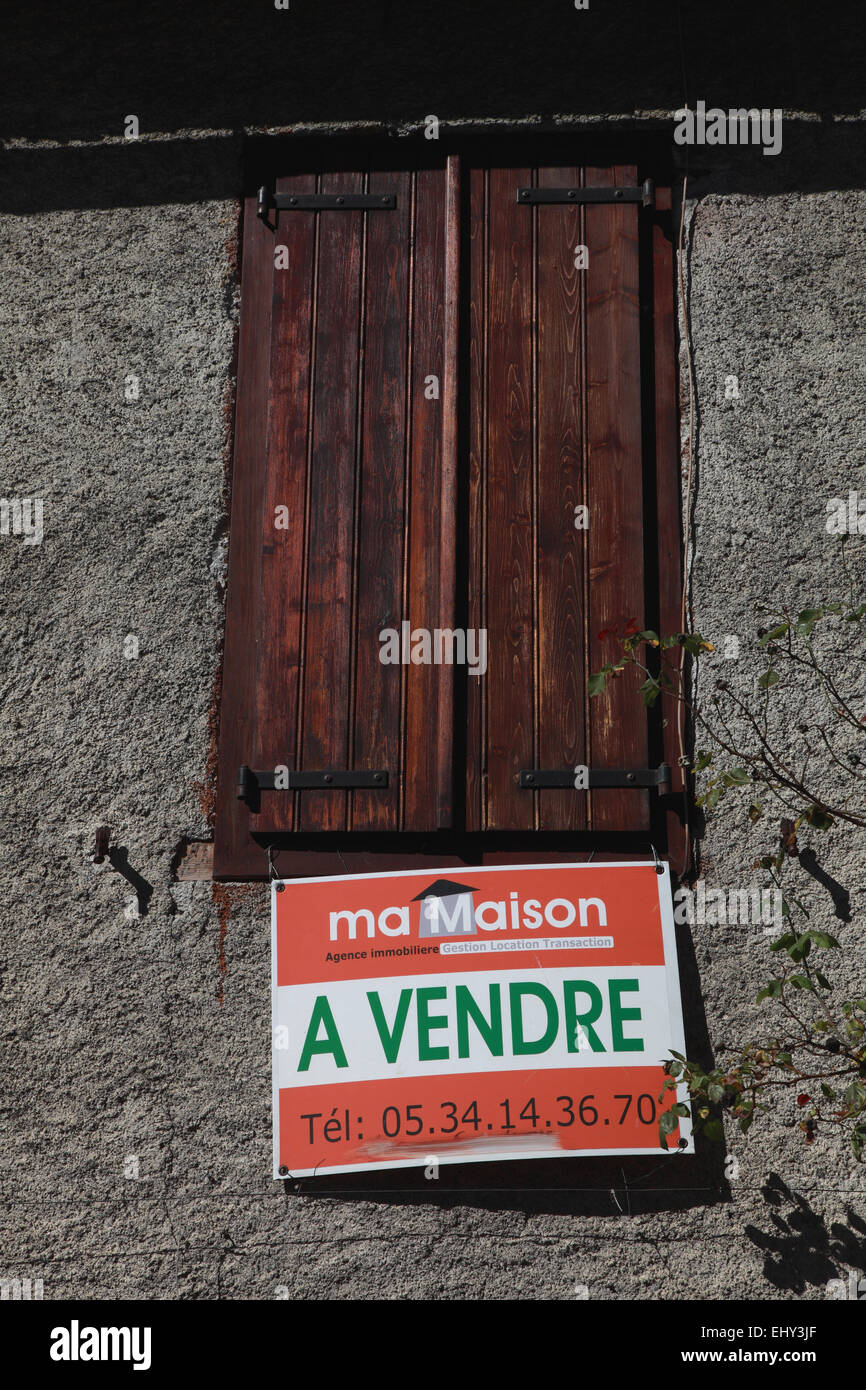 Sign saying a house for sale in Argein, a village in Ariege department in  Midi Pyrenees in south western France - Stock Image