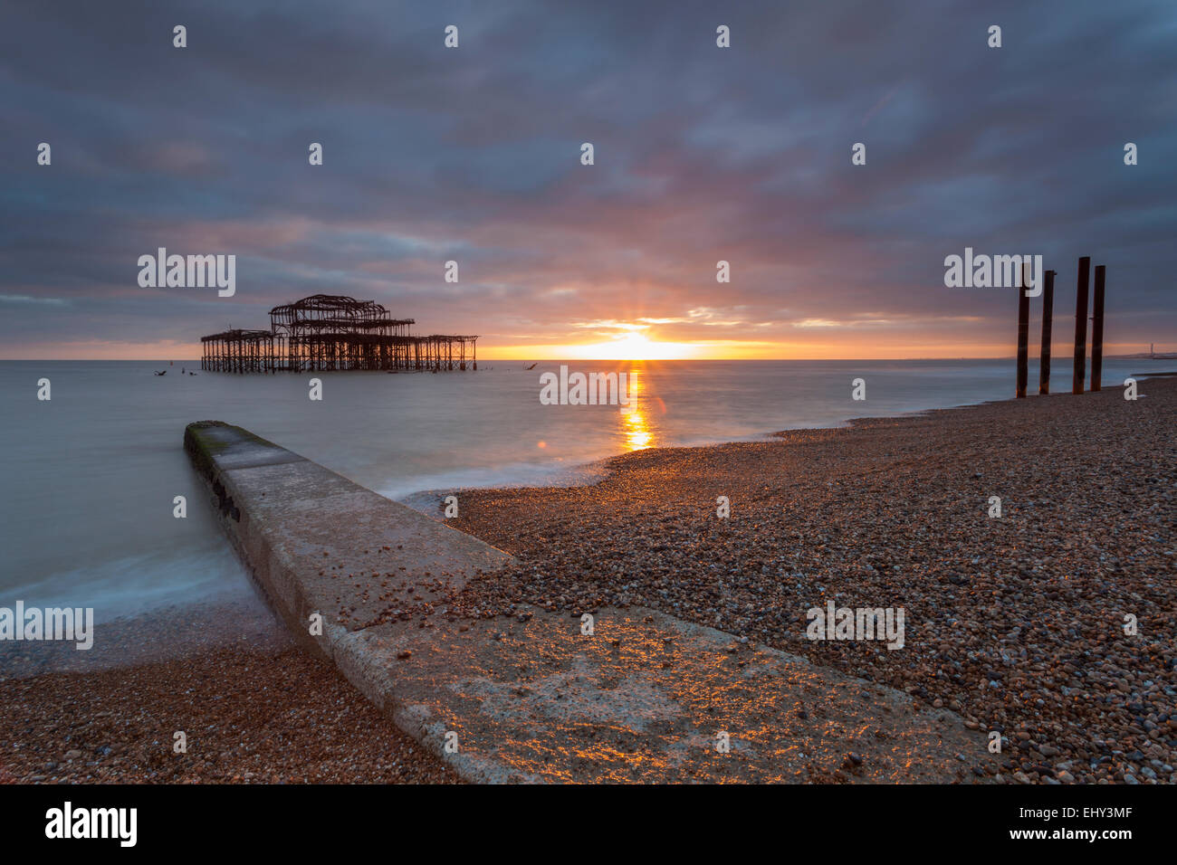 Sunset at West Pier ruins in Brighton, East Sussex, England. - Stock Image