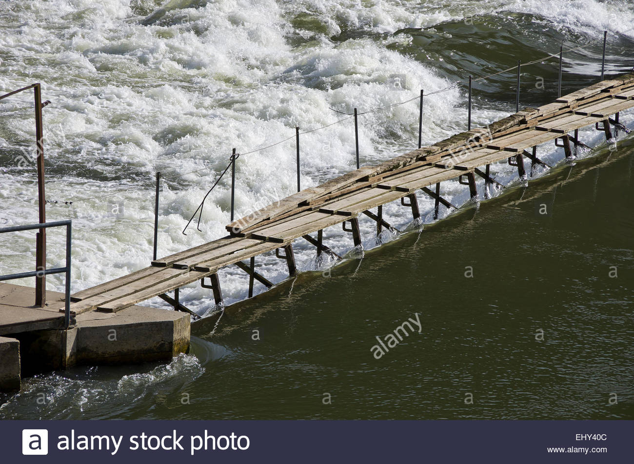 Weir In A River. - Stock Image