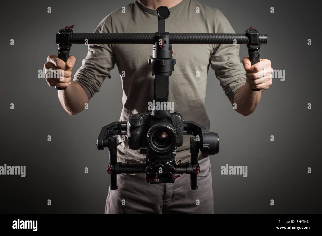 Professional videographer with gimball video slr - Stock Image