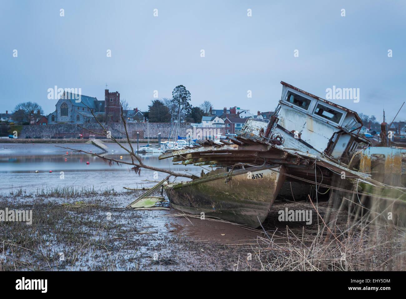 Boat wrecks on river Exe in Topsham near Exeter, UK. - Stock Image