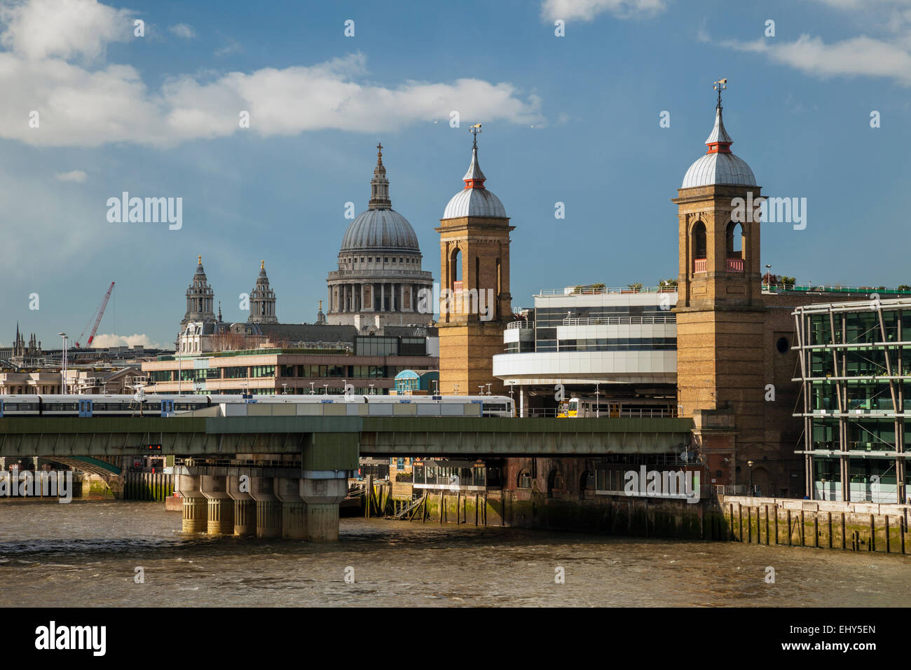 Cannon Street Railway Bridge in London. St Paul's Cathedral in the background. - Stock Image