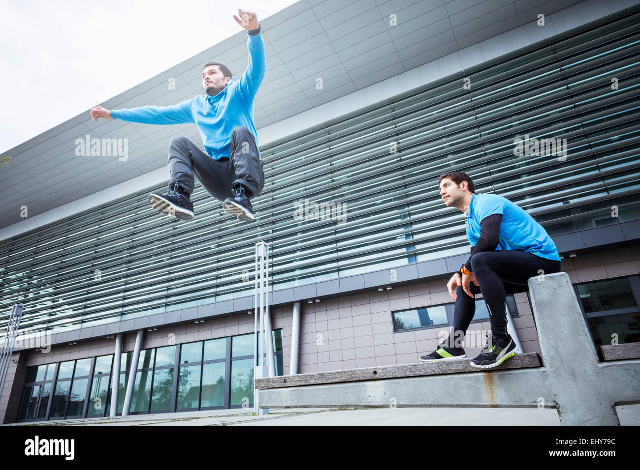 Male runners doing sports training in city - Stock Image