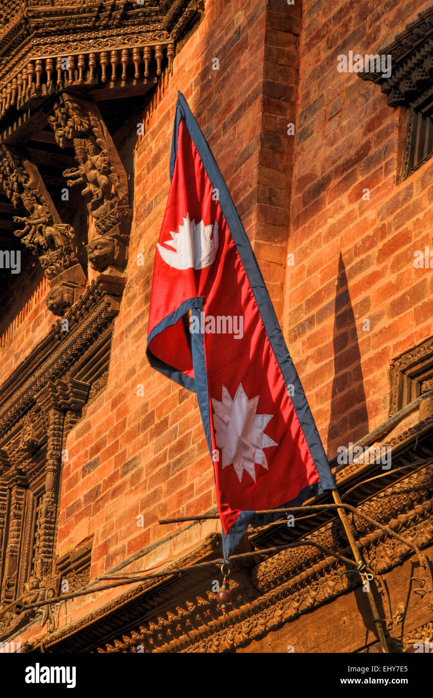 Nepalese flag on brick building wall - Stock Image