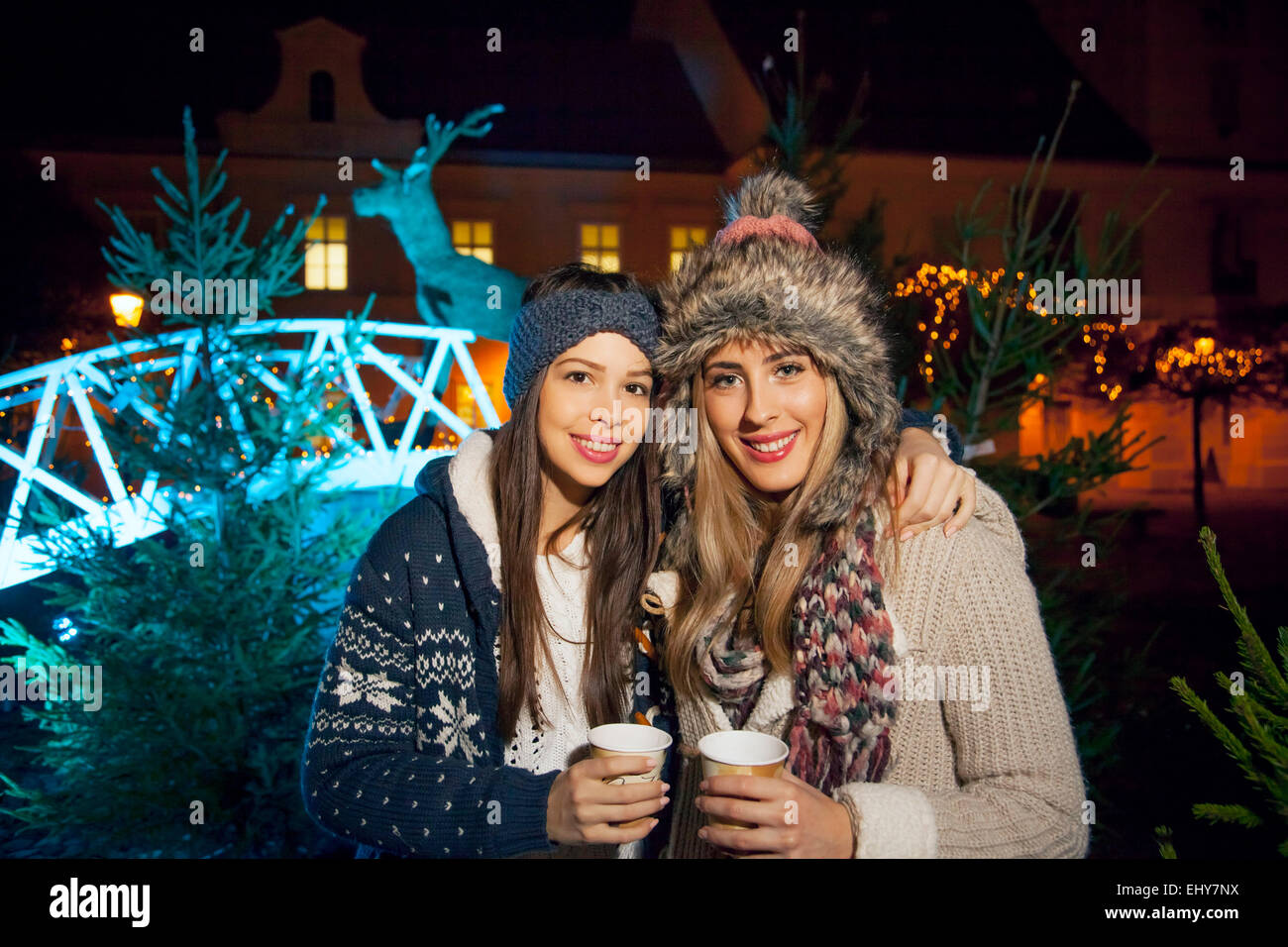 Two women having punch at Christmas Market - Stock Image