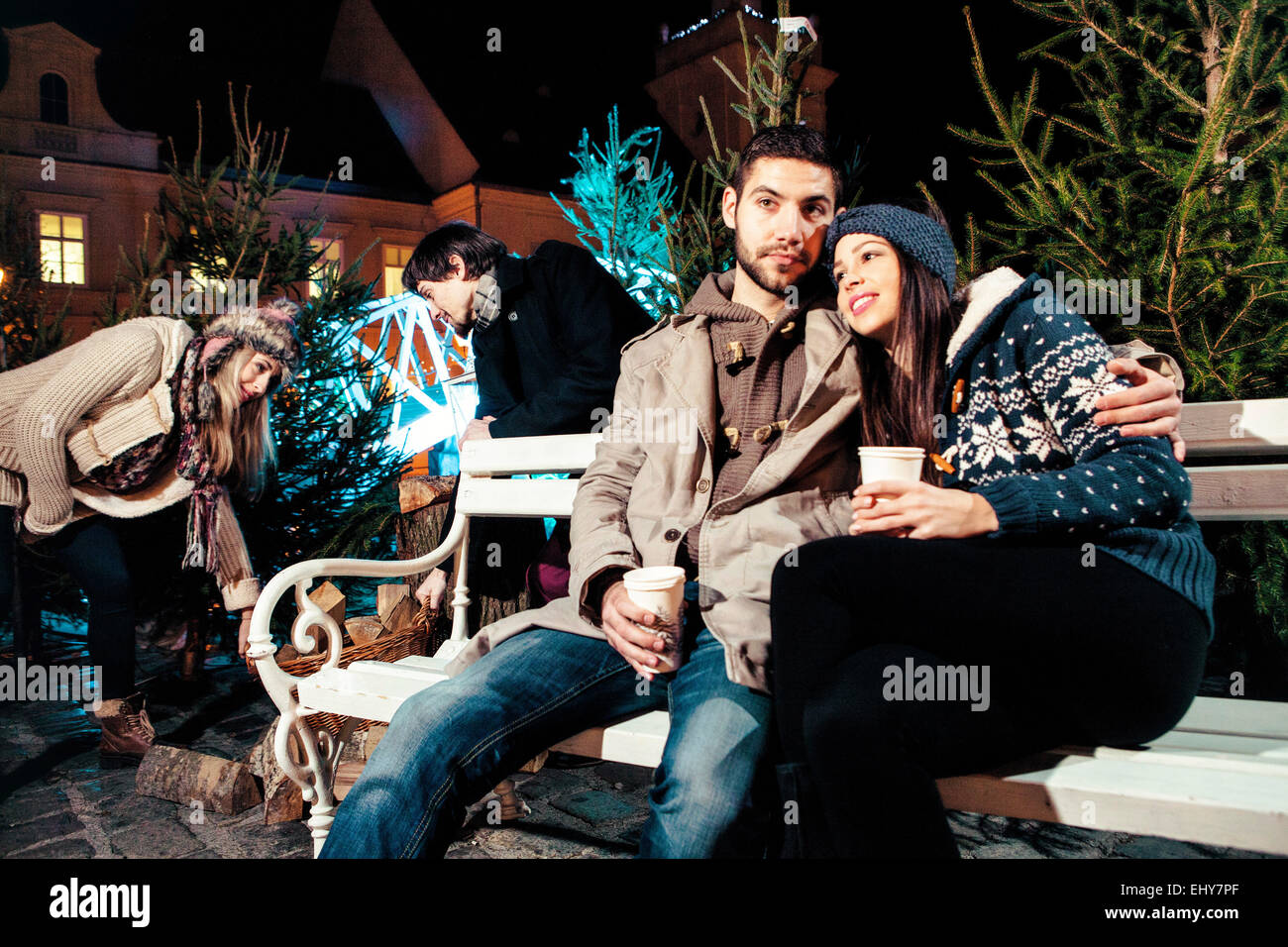 Young couple drinking punch at Christmas Market - Stock Image